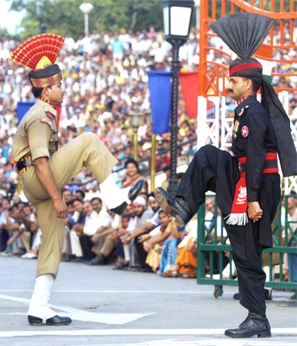 Soldiers performthe Beating the Retreat ceremony at the Indo-Pakistani border post at Wagah-Attari