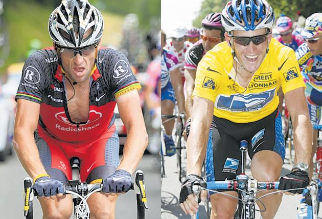 Lance Armstrong suffers on the road to Pau (left) as he tries to stay in Tuesday's breakaway, a contrast to his seven years of finishing in yellow