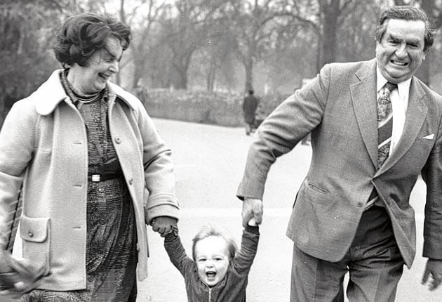 Healey and her husband Denis, then Chancellor, with their grandson in 1977