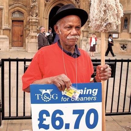 A House of Commons cleaner protests over pay: Armies of workers remain largely invisible