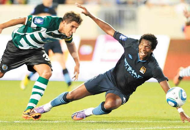 Heading for a fall: Man City's Jo Silva takes a tumble during the defeat against Sporting Lisbon