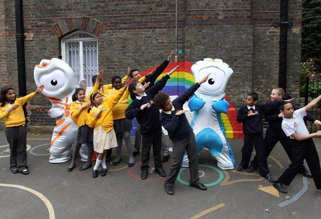 High expectations: Olympic and Paralympic mascots pose with Seb Coe and schoolchildren in May