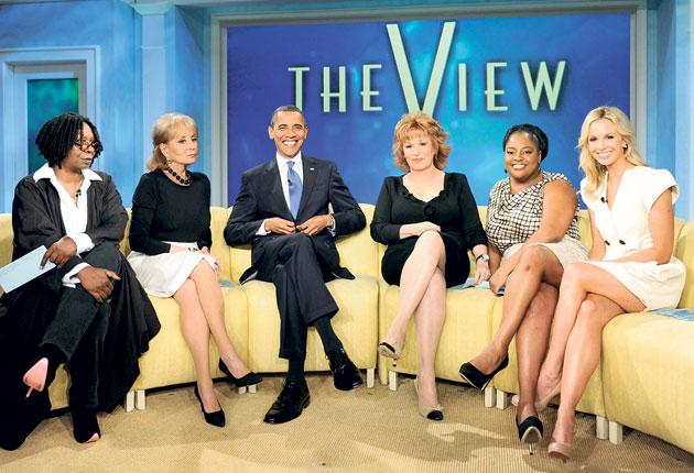 President Barack Obama takes his seat on the chat-show couch with The View co-hosts, left to right, Whoopi Goldberg, Barbara Walters, Joy Behar, Sherri Shepherd and Elisabeth Hasselbeck