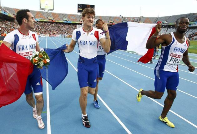 Christophe Lemaitre (second left) celebrates winning the 4x100m gold with teammates yesterday