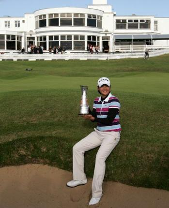 Yani Tseng holed a six-foot putt on the last to claim her third major crown