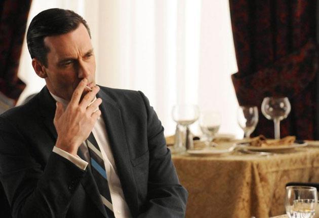 Jon Hamm as the chain-smoking, hard-drinking Don Draper in Mad Men