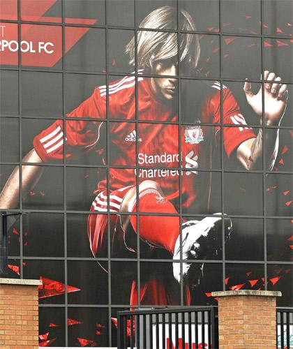 A giant poster of Fernando Torres greets fans at Anfield