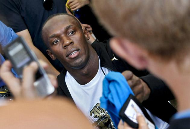 World-record holder Usain Bolt is mobbed by fans in Stockholm yesterday