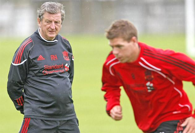 Liverpool manager Roy Hodgson and captain Steven Gerrard at the club's training ground yesterday