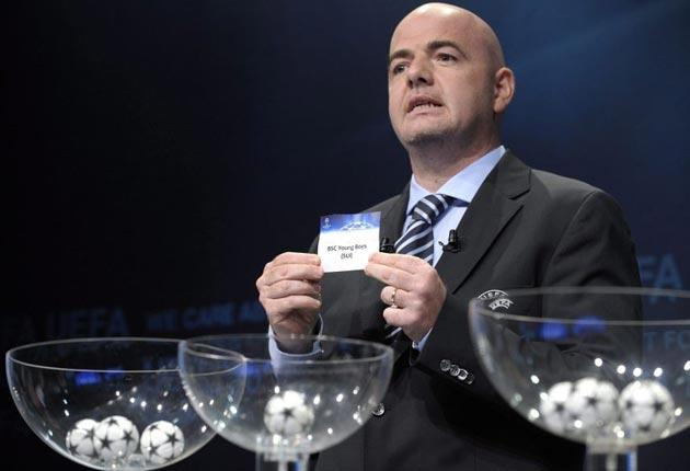 UEFA General Secretary Gianni Infantino draws Swiss soccer club Young Boys Bern against Spurs for the final Champions League 2010/11 play-offs round