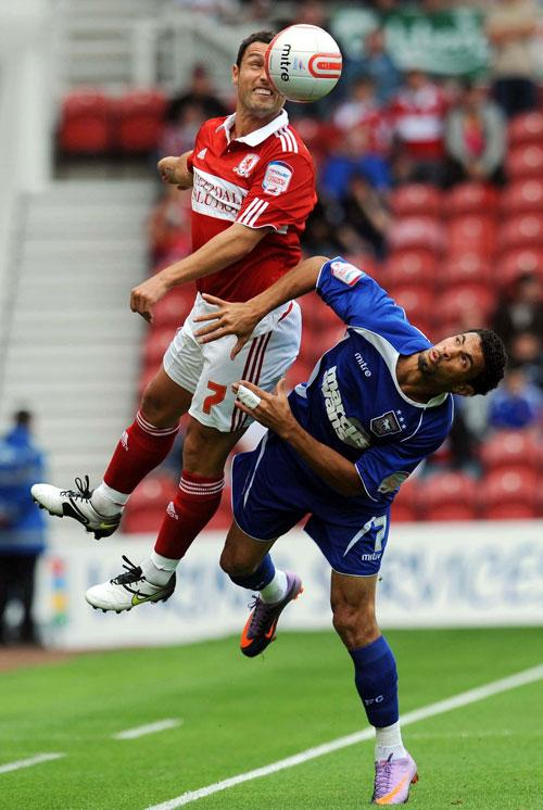 Middlesbrough goalscorer Scott McDonald (top) jumps for the ball with Ipswich's Jaime Peters during an exciting clash at the Riverside Stadium