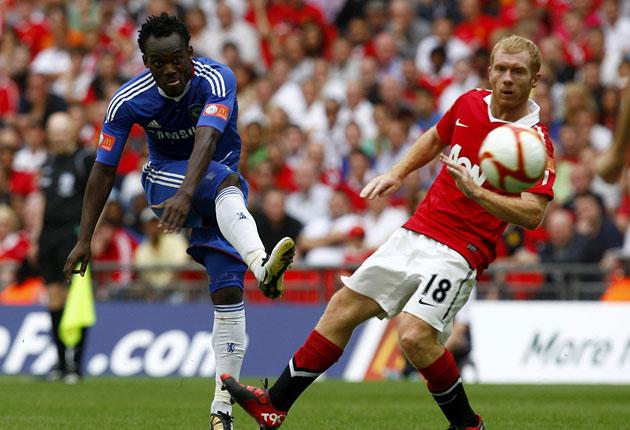 Chelsea's fit-again Michael Essien beats Paul Scholes to shoot at Wembley yesterday