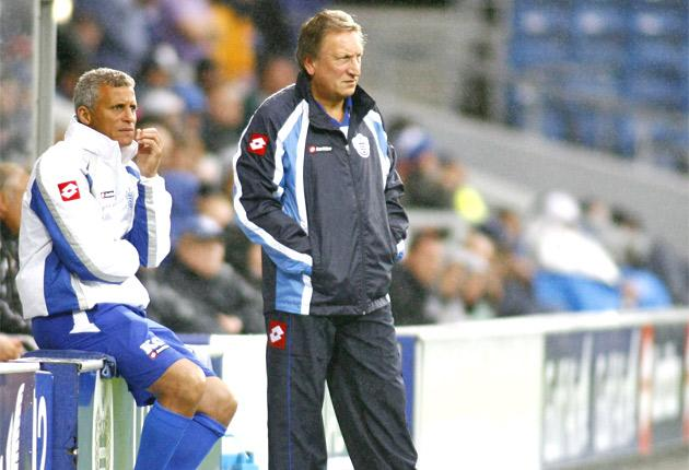QPR manager Neil Warnock (right) and assistant manager Keith Curle look on as their side slumps to a 3-1 home defeat against Port Vale