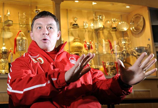 Billy Davies claims to be operating with hands behind his back in the transfer market but is still confident that Nottingham Forest can earn promotion after the agonies of last season