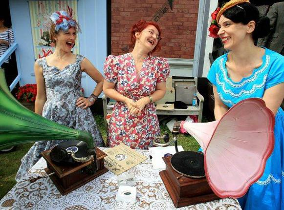 Ladies in vintage clothing enjoy the atmosphere during Day 3 of the Vintage at Goodwood Festival