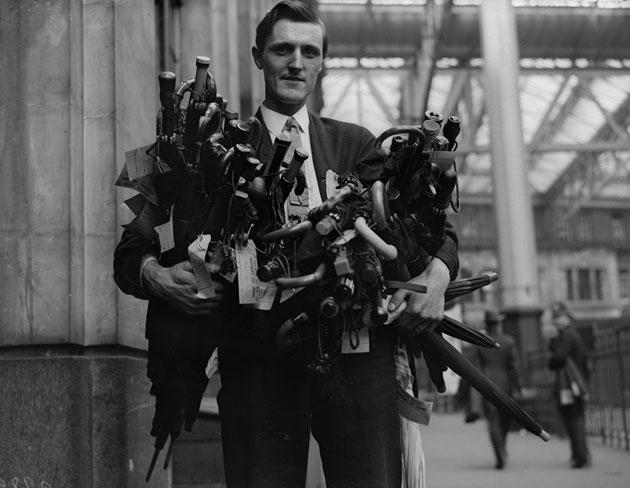 An armful of umbrellas found on Southern Railway's trains and consigned to the lost property depot in 1930.