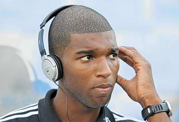 Liverpool's Ryan Babel picks up the beat from his 'anti-social' MP3 player