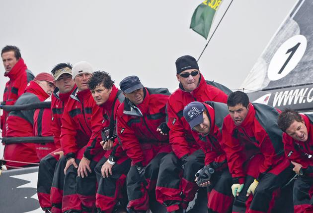 Anthony O'Leary (second left) concentrates on helming as the crew of his yacht Antix looks forward to Irish victory in the Rolex Commodores' Cup.