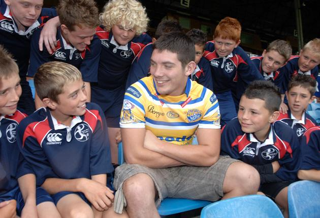 Chris Clarkson talks to the children from Temple Moor, his old school