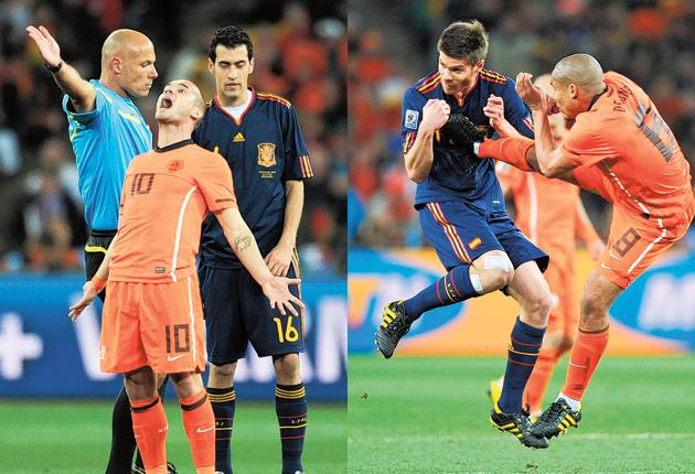 The Netherlands' Wesley Sneijder betrays players' frustration at Webb;  Nigel de Jong's foot hammers into the chest of Spain's Xabi Alonso, an incident Howard Webb admits to officiating wrongly by giving only a yellow card