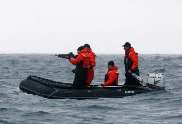 Vladimir Putin aims a crossbow on the Olga Bay marine reserve