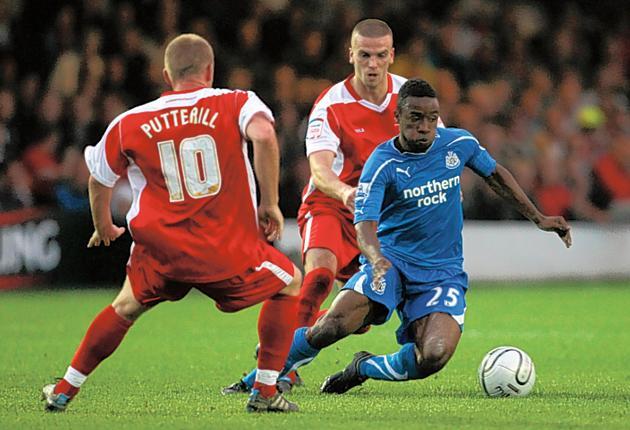 Kazenga LuaLua takes on the Accrington defence