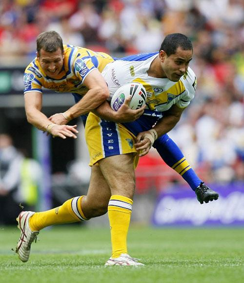 David Solomona (right) is tackled by Leeds' Danny McGuire during the Challenge Cup final at Wembley