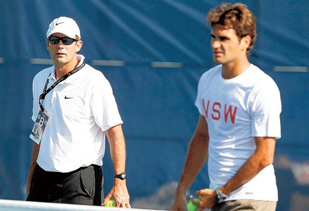 Roger Federer practises with Paul Annacone earlier this month