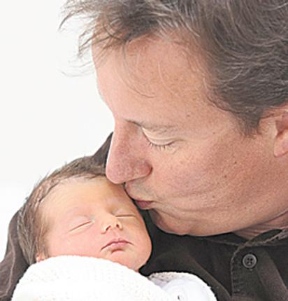 The 'sickly-sweet' official snaps of proud Prime Ministerial dad David Cameron and his newborn, Florence Rose Endellion