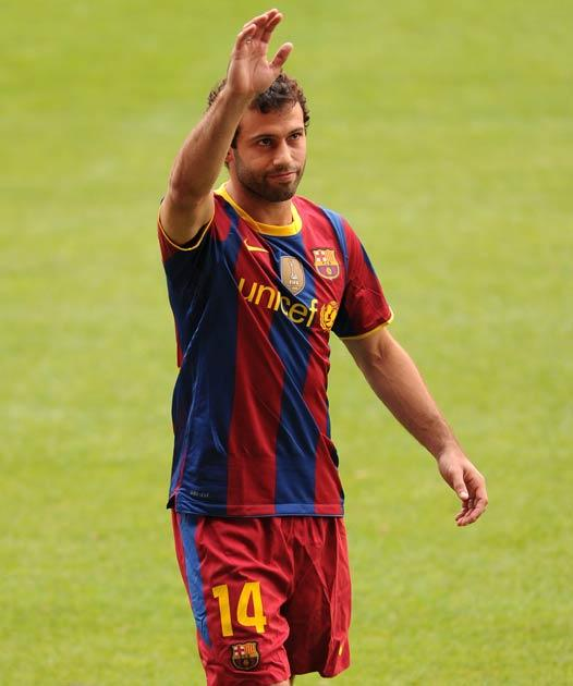 Mascherano pictured at his Barcelona unveiling yesterday