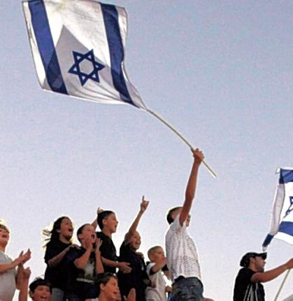 Jewish settlers stage a demonstration to break the construction freeze at the settlement of Adam this week