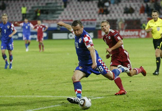 Ivica Olic of Croatia shoots in the Euro 2012 qualifier against Latvia, whose fans were the happiest I have ever seen
