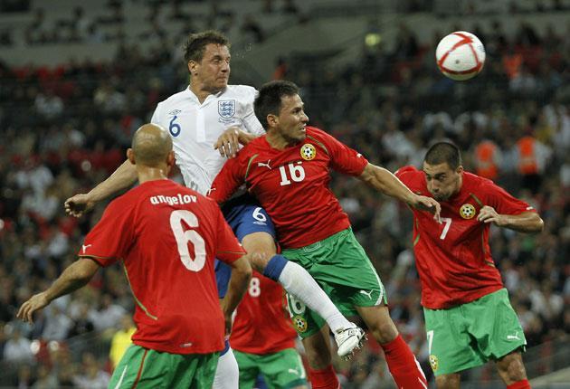 England defender Phil Jagielka climbs highest against Bulgaria