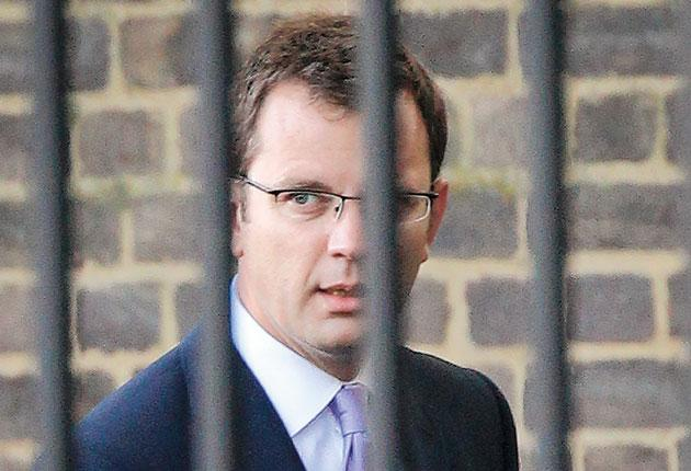 Andy Coulson arrives using the back entrance to Downing Street yesterday