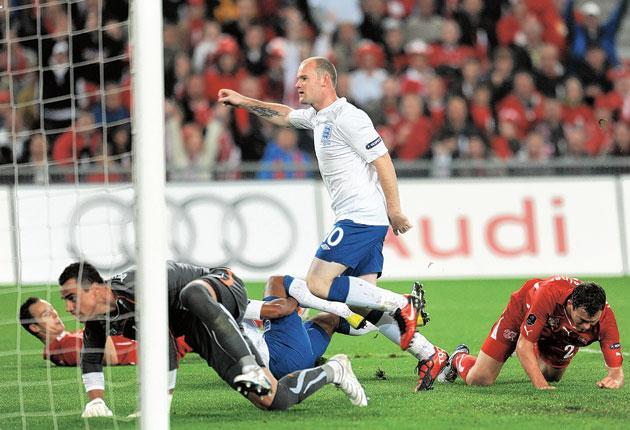 Wayne Rooney slots in England's first goal against Switzerland in Basle last night