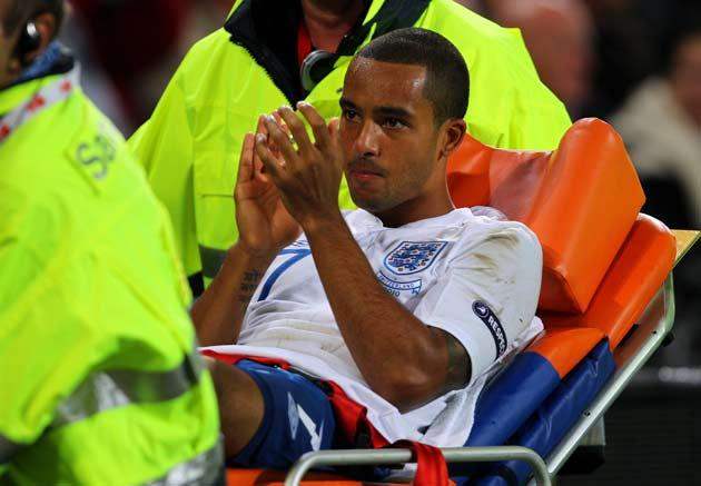 Walcott was stretchered off