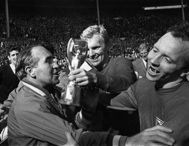 Stiles pictured right alongside Alf Ramsey and Bobby Moore