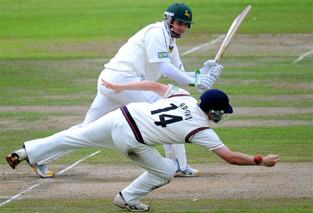 Lancashire's Karl Brown just fails to grab Paul Franks's clip to leg as Notts reach 89-2 in yesterday's brief action