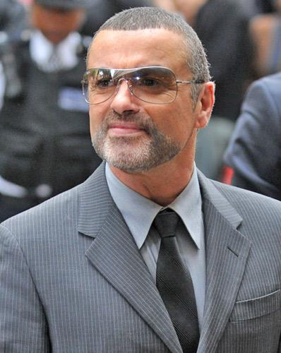 George Michael arrives at court yesterday morning, charged with driving under the influence of drugs