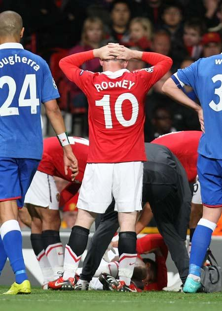 Rooney looks on as Valencia lies on the ground