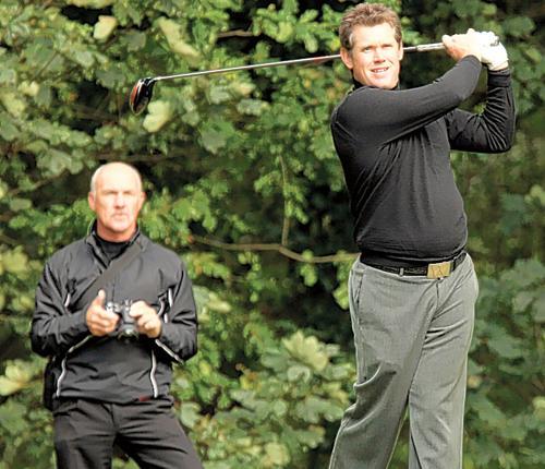 Lee Westwood practises at Worksop Golf Club under the watchful eye of coach Pete Cowen yesterday