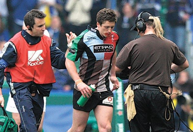 Steph Brennan (left) with Tom Williams, of Harlequins, after the incident that has cost him his career