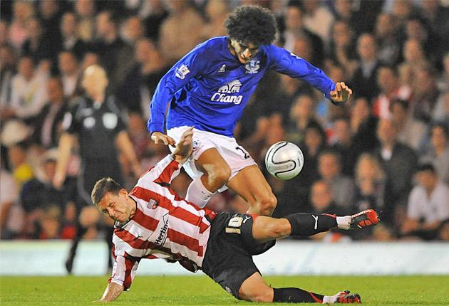 Marouane Fellaini and Brentford's Charlie MacDonald battle for the ball during last night's Carling Cup encounter