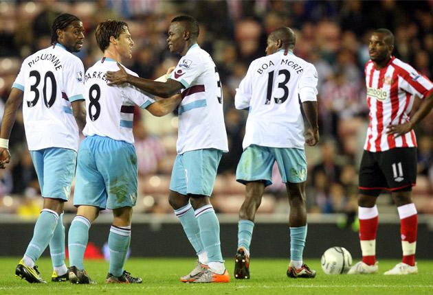 West Ham players congratulate Victor Obinna (centre) after the striker scored his first goal for the London club