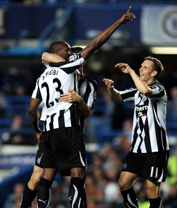 Shola Ameobi celebrates his first goal of the night before he scored an injury-time winner to send Chelsea out of the Carling Cup
