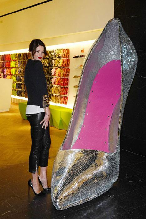 Gemma Arterton stands next to a giant shoe as she opens the Selfridges Shoe Gallery
