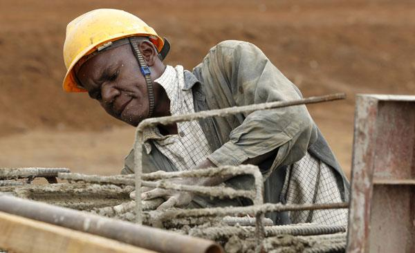 A construction worker at a highway bridge project near Nairobi in Kenya, one of the continent's better-developed areas
