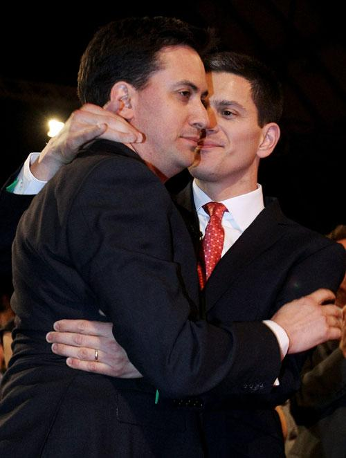 Ed Miliband (left) gets a hug from beaten brother David. History says the rivalry is not yet over