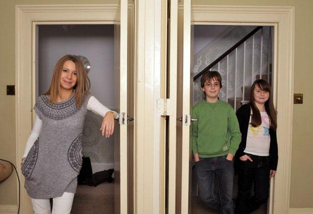 Half and half: Kathleen Saxton with her children Ned and Nancy, have found a way of living that works