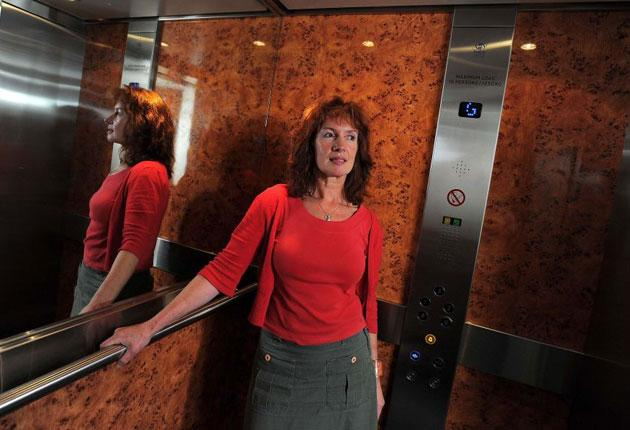 No longer floored: Deborah Dooley takes a ride in a lift, which once would have caused her to panic, after her session with Phil Parker